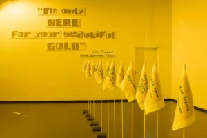 A yellow-lit showroom. On the wall is a quote